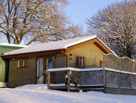 image of One Night Stay At The Swansea Log Cabin for Two